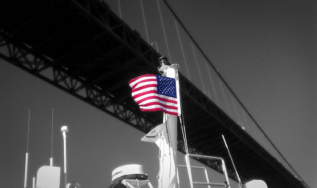 golden gate bridge with american flag